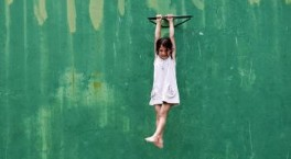 Girl hanging green